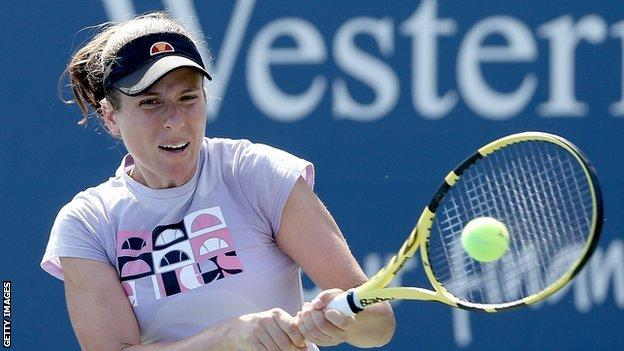 Johanna Konta hits a return at the Western and Southern Open in New York