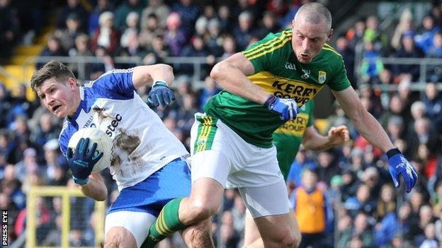 Kerry's Kieran Donaghy battles with Monaghan's Darren Hughes at Clones