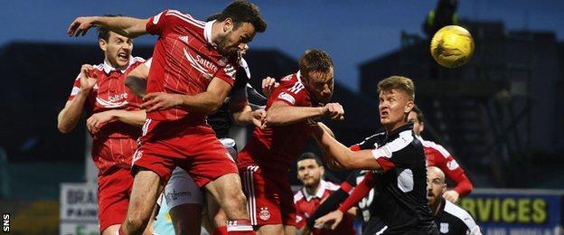 Aberdeen's Andy Considine rose highest to break the deadlock at Dens Park
