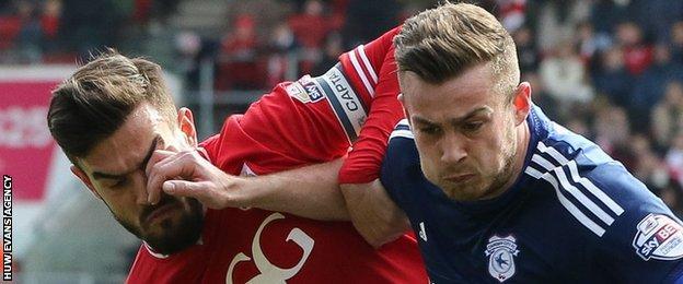 Joe Ralls of Cardiff City holds off Bristol City's Marlon Pack