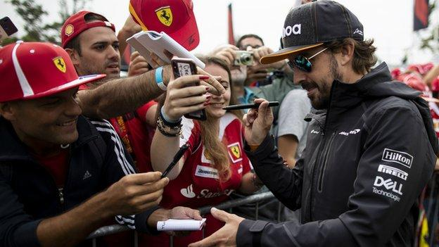Fernando Alonso signs autographs for Ferrari fans at Monza in 2018