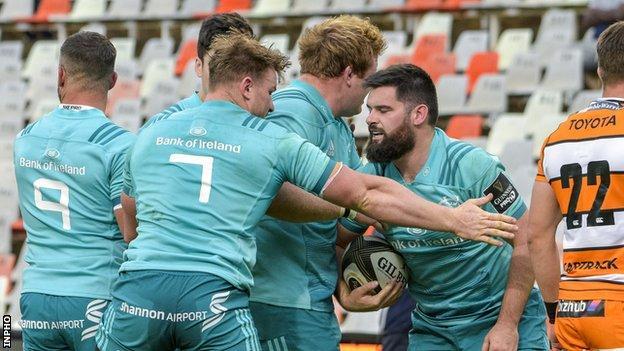 Munster celebrate Kevin O'Byrne's try in Bloemfontein