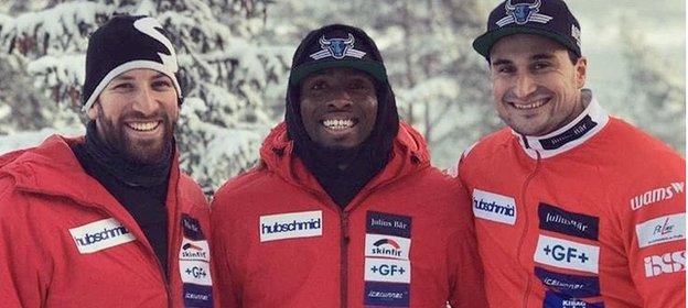Joel Fear (centre) with Swiss bobsleighers