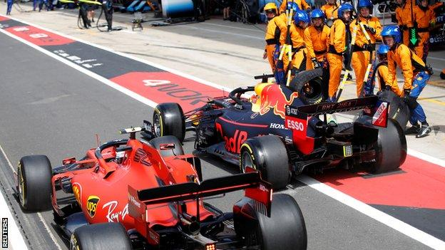 Charles Leclerc and Max Verstappen in the pit lane at the British Grand Prix
