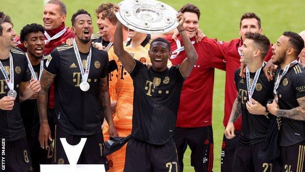 David Alaba celebrates winning Bundesliga Meisterschale Trophy with Bayern Munich