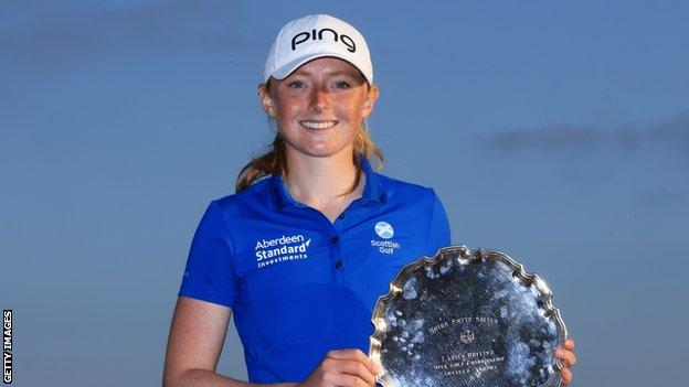 Louise Duncan lifts the Smyth Salver for finishing the leading amateur at the Women's Open