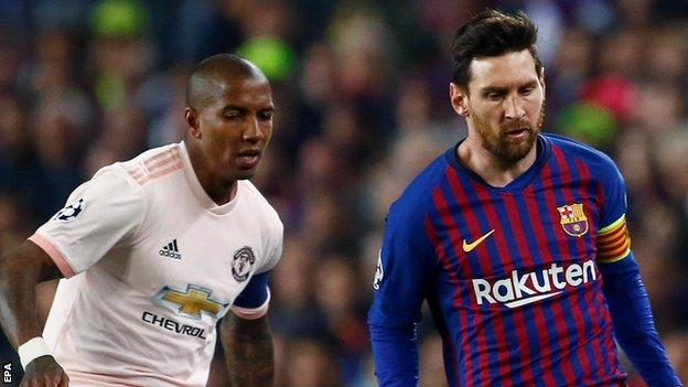 Manchester United defender Ashley Young (left) and Barcelona forward Lionel Messi