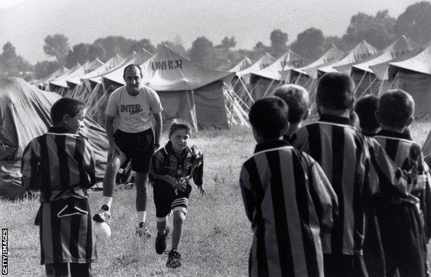 Kosovan boys play football at an Intercampus training session in a refugees Camp in Albania during the Kosovo war