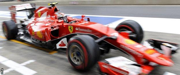 A baffled Kimi Raikkonen went out in a frenetic first qualifying session