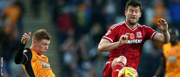 David Nugent (right) and Sam Clucas compete for a loose ball.