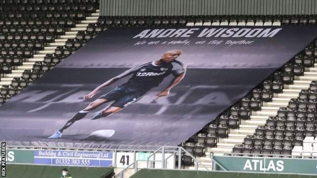 A flag in support of Andre Wisdom