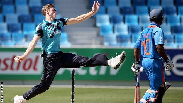 Gavin Main bowls for Scotland at the Under-19 World Cup in Dubai in 2014