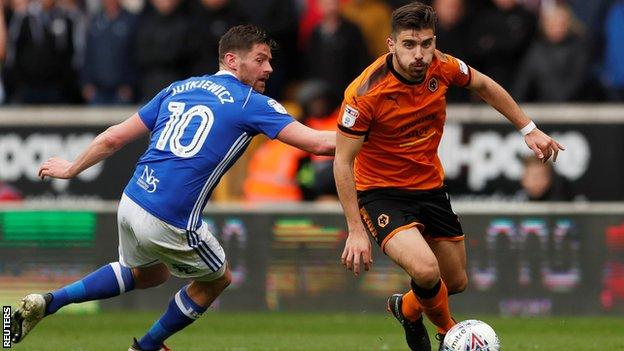 Ruben Neves dribbles the ball past an opponent