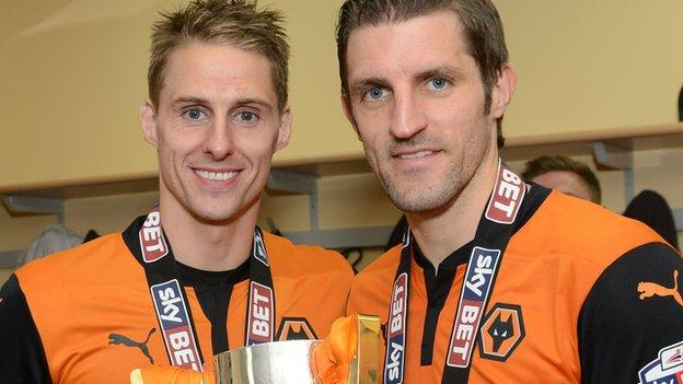 Sam Ricketts (right) and Dave Edwards celebrate winning the League One title with Wolves in 2013-14