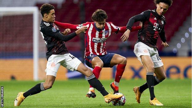 Joao Felix (centre) challenges Bayern Munich players