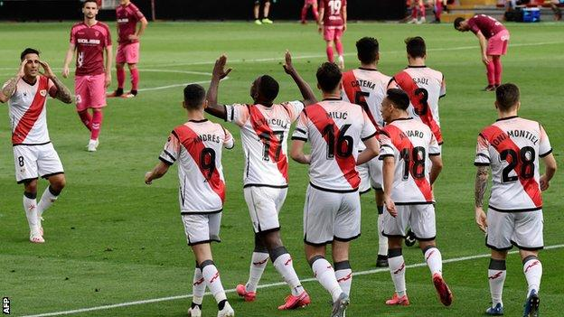 Rayo Vallecano's players celebrate scoring against Albacete as football resumed in Spain
