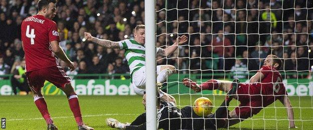 Jonny Hayes stretches to score for Celtic against Aberdeen