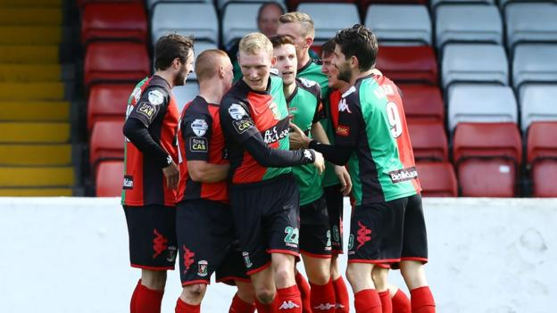 Glentoran players gather to congratulate Marcus Kane after he scored the only goal in the win over Portadown