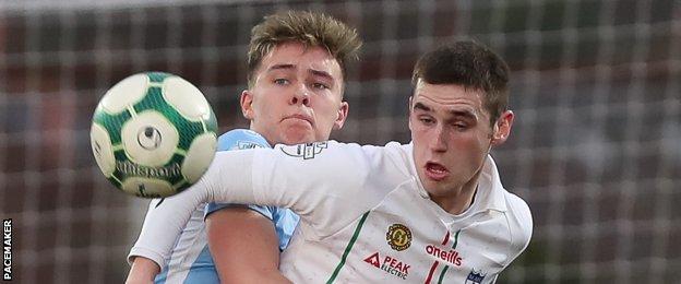 Ballymena's Kofi Balmer in action against Mark McCabe of Newry City