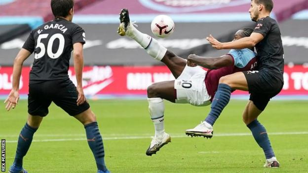 Michail Antonio scores for West Ham against Manchester City in the Premier League