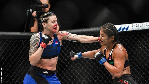 Joanne Calderwood, (left) in action against Cynthia Calvillo during their strawweight bout at UFC Fight Night Glasgow in July 2017