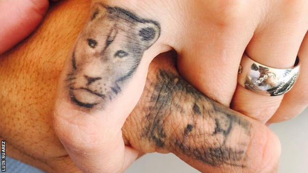 A lion and lioness tattoo