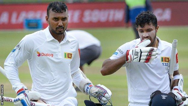 Oshada Fernando and Kusal Mendis walk off after Sri Lanka win the Test series