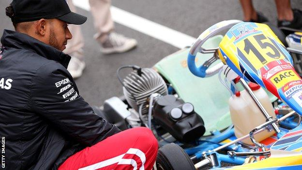 Lewis Hamilton inspects a kart on the track at Circuit de Barcelona-Catalunya