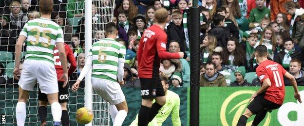 Kilmarnock's Jordan Jones (right) scores against Celtic last season