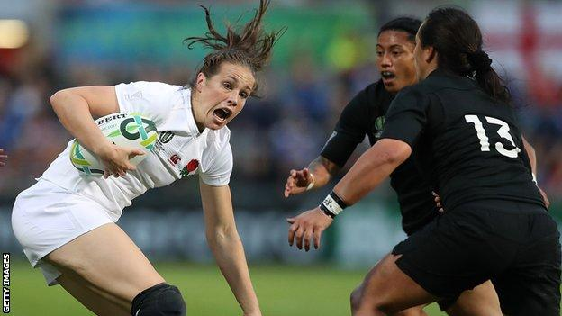 England's Emily Scarratt takes on the New Zealand defence