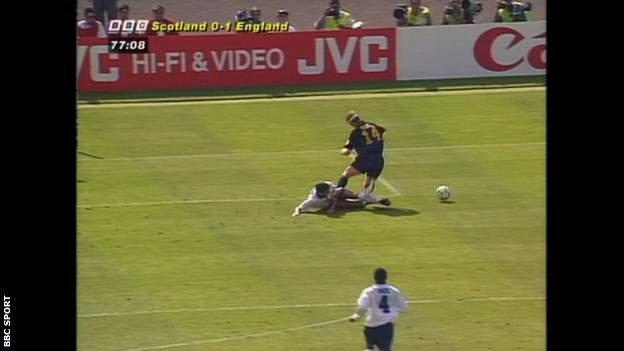 Tony Adams fouls Gordon Durie for Scotland's penalty