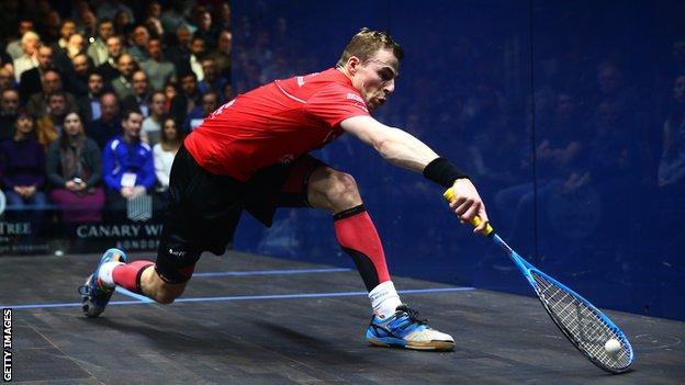 Nick Matthew reaches for a backhand during a squash match