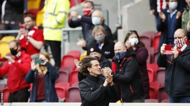 Brentford manager Thomas Frank applauds the fans before their play-off semi-final second leg against Bournemouth in May 2021