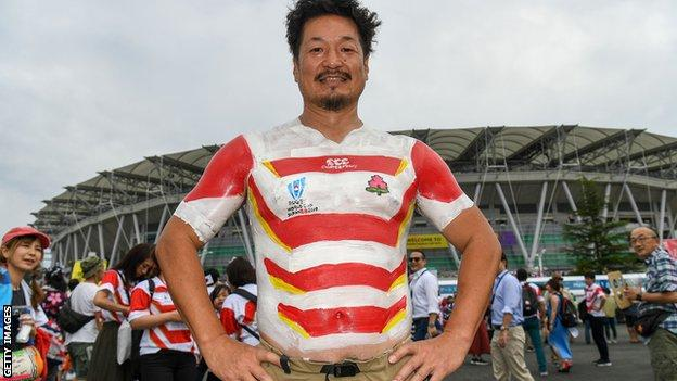 Japan fan with a painted-on national team shirt