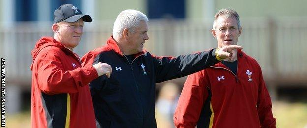 Wales coaches Neil Jenkins (left), Warren Gatland (centre) and Rob Howley oversee training in Colwyn Bay