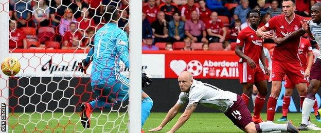 Steven Naismith dives in to head Hearts level at Pittodrie