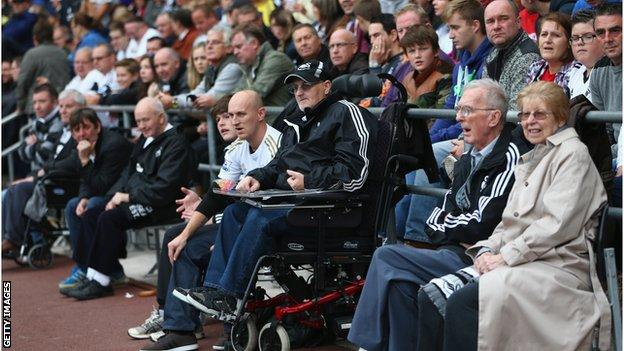 Disabled supporters of Swansea City look on during the Barclays Premier League match between Swansea City and Arsenal at the Liberty Stadium on September 28, 2013
