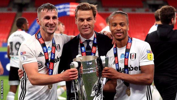 Joe Bryan, Scott Parker and Bobby Decordova-Reid with the play-off trophy