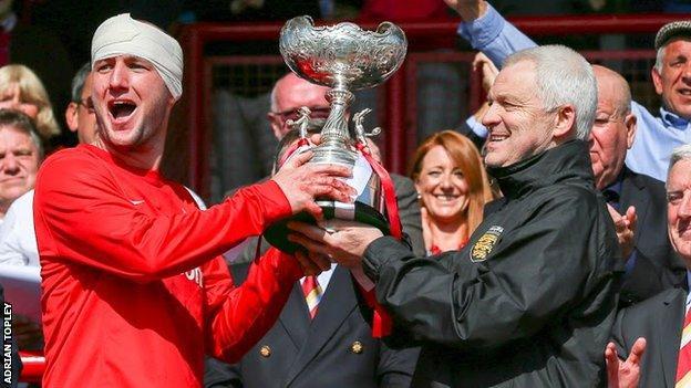 Brian Little and jersey captain Luke Watson lift the Muratti Vase in 2016