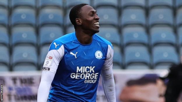 Idris Kanu celebrates a goal for Peterborough