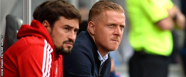 Pep Clotet and Garry Monk watching Swansea City in action