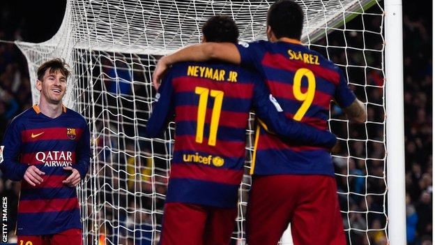 Lionel celebrates with team-mates Neymar and Luis Suarez after scoring against Real Sociedad