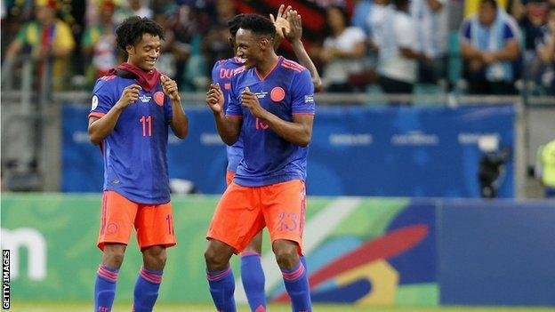 Colombia's Juan Cuadrado and Yerry Mina celebrate