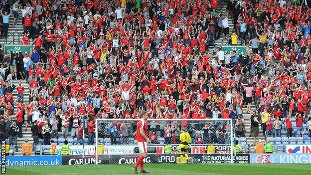 The scene behind the goal after Barnsley's equaliser at Wigan