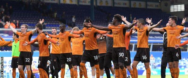 Wolves players celebrate in front of away fans at Birmingham