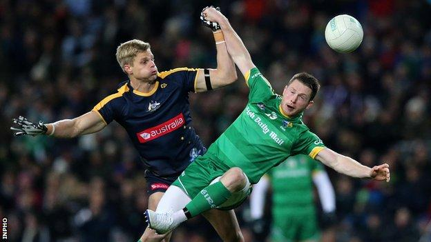 Australia's Nick Riewoldt battles with Ireland's Michael Quinn at Croke Park