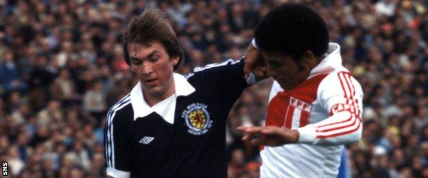 Scotland's Kenny Dalglish (left) is tackled by Hector Chumpitaz