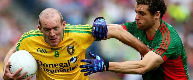 Neil Gallagher is tackled by Tom Parsons as Donegal crash to Mayo in Saturday's All-Ireland quarter-final