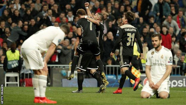 Real Madrid players look distraught as Ajax celebrate at the Bernabeu