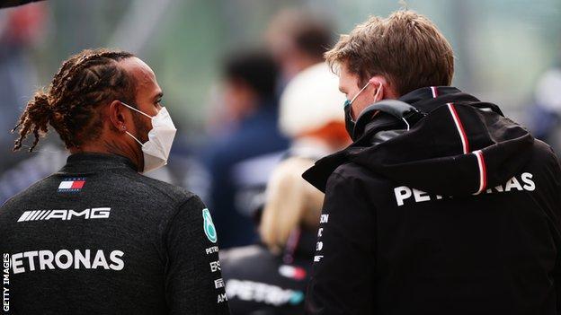Lewis Hamilton and a Mercedes crew memeber